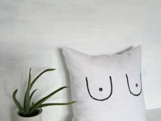 "This pillow cover is made with a white linen and block printed with black boobs. The cover is fully washable and has an invisible zipper for closure.  This pillow cover is made to order and is available in several different sizes as shown in the drop down menu.  The pillow cover shown is 16"" x 16"" (41cm x 41cm)  Caring for your pillow cover: spot clean, hand-wash, lay flat to dry. If needed, machine wash cold on gentle cycle, lay flat to dry.  *This listing is for the pillow cover only…"