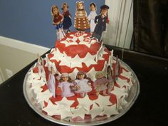 American Girl doll cake using stickers (purchased on Amazon) dressed with printed costumes of favorite characters and fondant stars