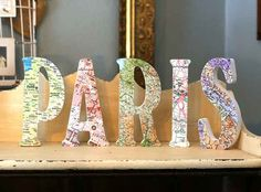 Repurpose some old maps to make awesome letters for your bedroom.