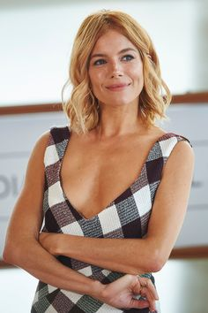 Sienna Miller with soft waves in Victoria Beckham