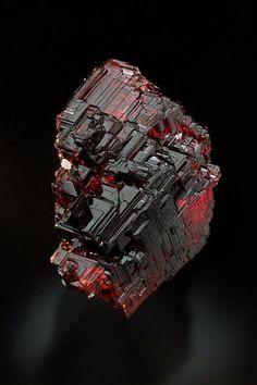 Spessartine Garnet. Minas Gerais, Brazil. #pixiecrystals : Etched deep red crystals.