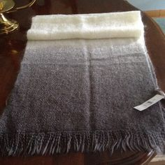 """Ombré Scarf Beautiful, softly woven scarf in Ivory with grey ombré fringed edges.  Scarf is 76"""" long including 2"""" fringe on each end. Ombré ends are 15"""" and blend 3 shades of grey. Striking. LOFT Accessories Scarves & Wraps"""