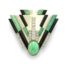 Rare and spectacular Art Deco brooch by Raymond Templier in 18k gold, diamonds, turquoise and onyx. Has been in an important museum exhibition in Paris at the musee des Arts Decoratifs..