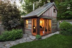 Wonderful Shed Ideas for Your Backyard and Garden Design: Outstanding Rustic Wooden Shed Ideas With Sliding Glass Main Door Two Level Home Design With Staircase And Wooden Roofing For Decorate Backyard With Green Plants Garden Home Design