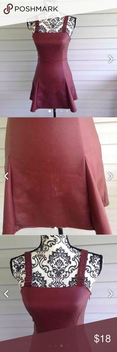 Tobi Maroon Pleather Skater Dress SZ small. This dress does have some wear and tear in the front as can be seen in the pictures on the pleather. Priced accordingly. Straps can be adjusted by buckle. Skater skirt. By Tobi Tobi Dresses Mini