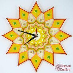 He encontrado este interesante anuncio de Etsy en https://www.etsy.com/es/listing/535505401/tejido-mandala-reloj-de-pared-reloj