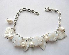 Bratara pentru mireasa model cu flori - accesoriu nunta Pearl Necklace, Charmed, Bracelets, Model, Jewelry, Pearl, Charm Bracelets, Mathematical Model, Bijoux