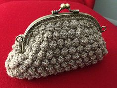 """Melody Ossola's retro-chic clutches, crocheted in a trio of 'KPPPM' colorways by Koigu Wool Designs, are worked from the bottom up in bobbled rows separated by single crochet. Coin Purse Pattern, Crochet Coin Purse, Purse Patterns, Crochet Patterns, Crochet Handbags, Crochet Bags, Tweed, Vogue Knitting, Crochet World"