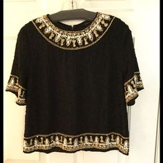 Black and gold beaded top NWOT, still has extra beading and sequin packet attached at tags. Gorgeous top for going out, or dress it down with jeans and sandals. Beading all over, with sequin and beading trim at hems and neckline. Back zip at top only. Never worn. Eternal Rose Tops Blouses