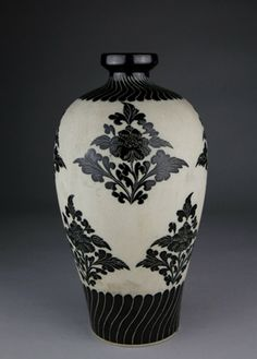 A CIZHOU CARVED VASE, MEIPING. The vase is carved plum flower. H:27cm