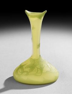 """Loetz Cameo Glass Vase, first quarter 20th century, the yellow-green glass vase cased in lime green, cut in patterns of flowers with butterflies and dragonflies, signed """"Richard"""" and pontil marked on base."""