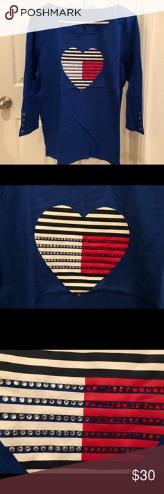 Tommy Hilfiger Studded Heart Top, XL / Blue Brand new with tags. The size is an XL and the color is blue. The shirt has a studded Tommy Hilfiger heart logo and the 3/4-sleeves have button details.  Width - 21.5 inches across bust Length - 25.5 inches Tommy Hilfiger Tops Tees - Long Sleeve