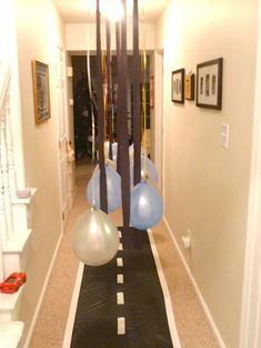 Cars Birthday Party hallway- really cute. We could start some baby races.