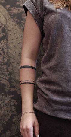 tribal line arm tattoos