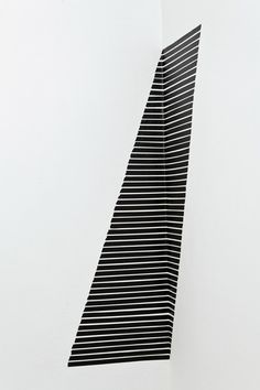 Joy Walker is a Toronto-based artist who used a corner of a room and black masking tape to created a striking piece.