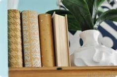 created these cute little books by taping decorative paper to the ...