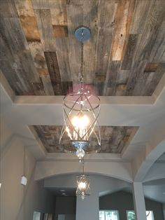 What a stunning accent feature! Double entry coffered ceilings with Stikwood paneling and two entry chandeliers! #GNW
