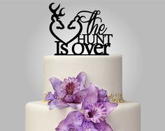 Bullets and kisses:   21 Adorably Unusual Wedding Cake Toppers