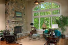 How to decorate a living room with large windows -- Curated by: Ductworks Heating and Air Conditioning | 104 - 2955 Acland road Kelowna bc v1x 7x2 | 250-765-8854