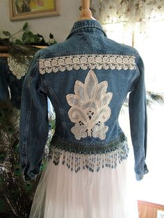 This is the cutest denim jacket that I have added to.  Size 6 USA or 10 UK.  Dark denim with added heart shaped crochet patch, lace and beaded blue fringe.  This item will need to be hand washed with line or hang to dry.  It will look great with jeans, skirt or over a dress.