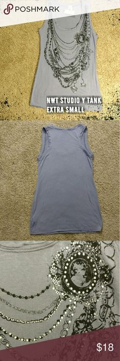 NWT Studio Y Embellished Tank -NWT! Studio Y ( from Maurice's) tank - purple tank with a black layered necklace print - raw edges   Bust: 14 inches Length: 26 inches   I will consider all reasonable offers!   No trades. No modeling. No PayPal. Studio Y Tops Tank Tops