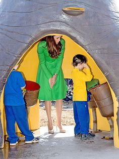 Kate ducks down for some playtime with children at the Pod Playground at the National Arboretum in Canberra, Australia, on Thursday, the royal family's last full day Down Under.