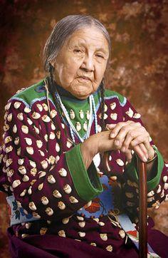 Winona Yellowtail Plenty Hoops has sewed thousands of elk teeth onto dresses.