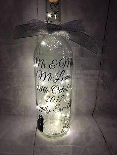 Wine Bottle Crafts – Make the Best Use of Your Wine Bottles – Drinks Paradise Wine Bottle Art, Painted Wine Bottles, Lighted Wine Bottles, Wine Bottle Crafts, Light Up Bottles, Bottle Lights, Bottles And Jars, Bottle Lamps, Wedding Wine Bottles