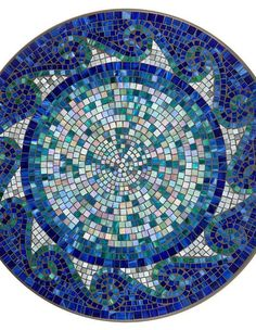 Bring the ocean to your outdoor tabletop with the colorful and vibrant KNF - Neille Olson Mosaics Ocean Waves Collection.