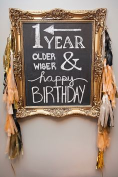 Gold gilded chalkboard sign for adult birthday party with DIY tissue tassels - Ashley Lindzon Events