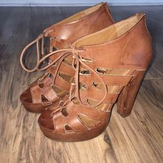 Brown Lace Up Heels Brown lace up heels. Mildly worn with a few nicks (as shown in photos). Heel size: 5 inches Shoes
