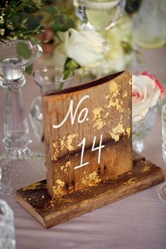 gold foil table numbers, photo by Pepper Nix Photography http://ruffledblog.com/backyard-chic-utah-wedding #weddingideas #gold #tablenumbers
