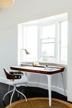 dark wood and white home desk and splay leg chair desire to inspire
