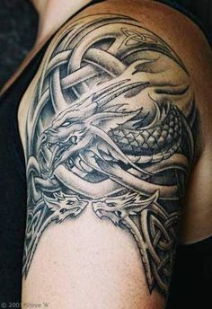 Celtic Arm Tattoos for Men | ... had a gorgeous celtic dragon tattooed design on his left upper arm