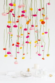 DIY Hanging Flower Installation So similar to the one we made last fall with crepe paper flowers. http://www.suburbanbitches.com/shes-crafty-crepe-paper-flowers/