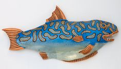 Blue Smacker by Byron Williamson. This is a fisherman's dream fish. Full of fight and flight he'll give an angler tons of sport. The artist makes each of his whimsical sculptures using traditional ceramic hand building methods: slab, coil and pinching. After the main slab form is completed, additional sculptural pieces are attached. After the piece is fired to cone 5, a cold finish is applied using metallic paints.