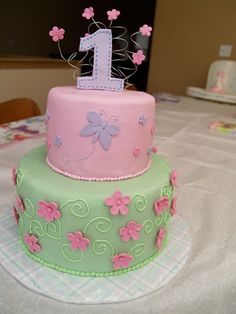 1st Birthday Cake - Made this for my daughter's 1st birthday party.  Her decorations had butterflies and flowers.  I lost my brand new butterfly mold and had to improvise at the last minute.  But I was pretty happy with it overall.  Most importantly, my baby girl enjoyed devouring it and getting it all over her face. :)