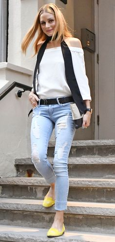 Yet another reason you need an off-the-shoulder top this summer: The breezy white style Olivia Palermo wore in New York City yesterday with light wash distressed jeans, and cheerful yellow loafers. Bonus points for the long skinny scarf casually draped around her neck—such a fun, trendy twist!