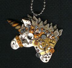 Polymer clay steampunk unicorn pendant.