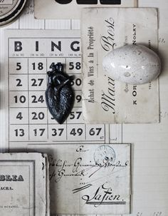 Graphite heart. Victorian decoy egg. Antique French calling cards and papers. Vintage bingo card.