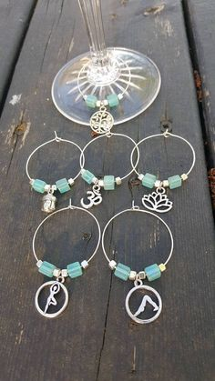 This fabulous set has 6 different markers for glass of wine. The blue marbles are beautiful! You will get a charm of : * Buddha * Ohm * tree of Life * Lotus flower * Yoga position tree * Yoga dog head down Communion, Articles, Charmed, Yoga, Turquoise, Wine, Bracelets, Glass, Etsy