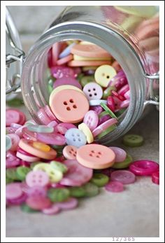 Buttons spilling out of jar