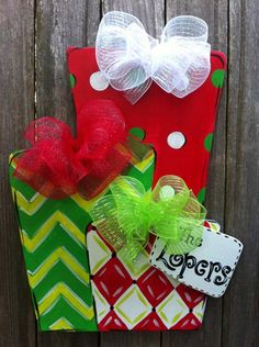 Christmas Presents Wooden Door Hanger Personalized Monogramed by Earthlizard on Etsy https://www.etsy.com/listing/202256303/christmas-presents-wooden-door-hanger