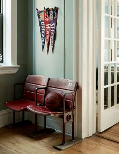 Old sports seats look fab in this masculine apartment
