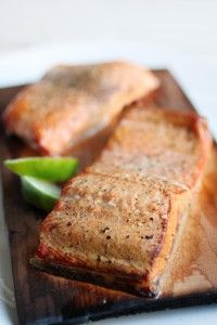 Cedar Plank Salmon with Lime - perfect for summer, this dish not only tastes great, but is beautifully presented right on the cedar plank. #paleo