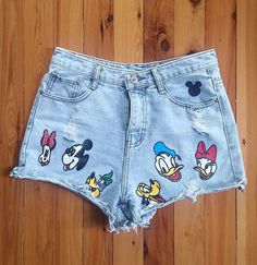 Upcycled Shorts, Ladies Shorts, Short Shorts, Cutoff Jeans, Shorties, Upcycled High Waist Shorts   Rockin ladies high waist upcycled denim shorts with Disney charachters. These shorts are in very good condition - no rips, stains or unintentional marks. There are 6 iron-on transfers of Disney characters including Minnie, Mickey, Goofy, Pluto, Donald and Daisy. Minnie Mouse is slightly slender but who doesnt love a skinny Minnie?! The mouse ears have been drawn on with fabric paint so the ink…