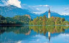 Lake Bled (Slovene: Blejsko jezero; German: Bleder See, Veldeser See) is a lake in the Julian Alps in northwestern Slovenia, where it adjoins the town of Bled. The area is a popular tourist destination. The lake is 35 km (22 mi) from Ljubljana International Airport and 55 km (34 mi) from the capital city, Ljubljana.