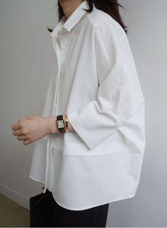 Camisa estruturada, com volume