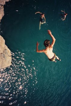 Cliff diving into water. Have you done this at Rick's Cafe in Negril, Jamaica? check it off Sooo fun