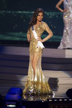 Noyonita Lodh, Miss India 2014 competes on stage in her evening gown during the Miss Universe Preliminary Show in Miami, Florida on January 21, 2015.